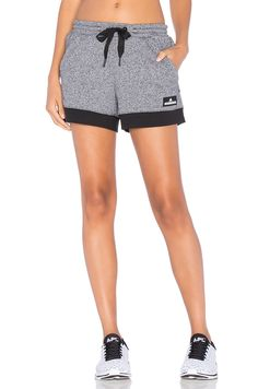 d992fd24d9 Shop for adidas by Stella McCartney Essentials Knit Short in Black   White  at REVOLVE.