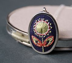 Embroidered Pendant Necklace Celery Spiral Bloom by SeptemberHouse, $29.00