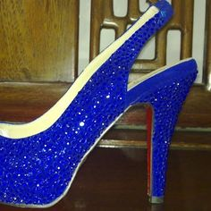 Gorgeous royal blue suede shoe has royal blue crystals covering the shoe. This shoe has a red sole, unless you specify that you want a natural color s