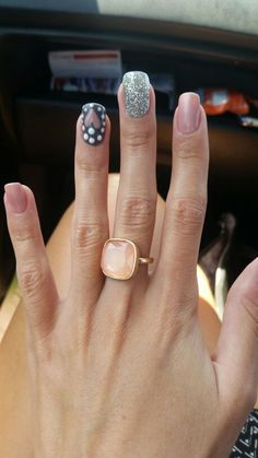 Rosy pink and glitter gel nails.