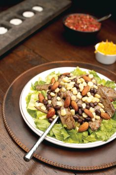 Steak Fajita Salad with Seasoned Almonds - Get all the sizzling spice of grilled steak fajitas over this flavorful salad dressed in citrusy cumin-lime vinaigrette.