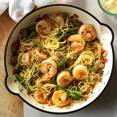 Asparagus 'n' Shrimp with Angel Hair Recipe -We've all heard that the way to a man's heart is through his stomach, so when I plan a romantic dinner, this is one dish I like to serve. It's easy on the budget and turns out perfectly for two. —Shari Neff, Takoma Park, Maryland