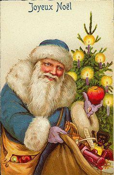 Vintage french christmas card. : Joyeux Noël Bleu robed Santa with sack of toys, near chtistmas tree. An apple on his hand.