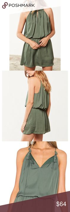 """bb dakota army green satin halter dress BB Dakota  'Kelving' Army green satin halter cocktail dress. This is an elegant, yet subtly casual mini dress. With a drop elastic waist, it creates a blouson appearance. Fully lined with neck keyhole. You can leave it untied for a more casual look. Ruffle neck accent.   size: medium approx measurements:        •bust across: 19""""        •waist across: 15.5""""        •total length: 36"""" condition: new with tags  ***all of my cover photos are edited; colors…"""