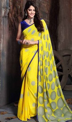 Garner compliments wherever you go draped in this lemon color shade georgette printed sari. The appealing block print and lace work a considerable feature of this saree. #womensarionline #indiansaris #bordersaricollection