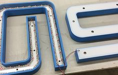 At LCI we specialize in LED Halo Channel Letters. This image is of the back side of an LED Channel Letter; The letter housing is made of HDU Sign Foam which is painted to a custom Pantone color. The front side of the Letter is Acrylic which is also painted on the 2nd surface with the same color match. The white acrylic reflector layer helps to shoot light back towards the wall, creating the Halo effect. http://www.lasercuttinginc.us/project/led-halo-channel-letters/
