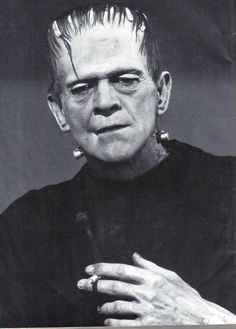 Boris Karloff taking a break on the set