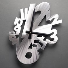 "Jumble Clock by Gerber Hand Brushed Aluminum Wall Clock. Hand shapes may vary 12 1/2 x 10 1/4"""
