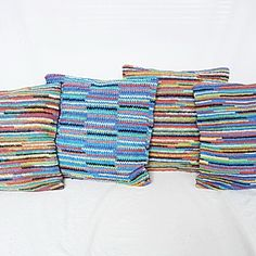 """Happy Pillow, crocheted from recycled plastic bags - La Pomme Kids """"To make this, La Pomme works with a group of women from economically depressed areas in Metro Manila, crocheting to make a living. The plastic bags used would have otherwise gone to landfills."""" plarn"""
