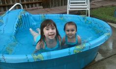 Olivia, age 4, and Ruby, age 2, enjoying their pool for the first time. Submitted by Heather G. -- Choose your favorite photo and submit your vote by August 6, 2012 for a chance to win a gift card for children's books!