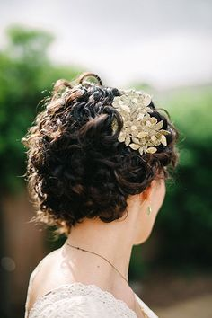 For a boho-chic look, tuck up your curled locks and add a gold leaf headpiece.