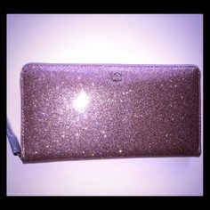 "Kate Spade Rose Gold Glitter Neda Large Wallet New! Gorgeous rose gold glitter kate spade Neda large wallet. Has inside zip pocket and tons of room for cards. Measures about 7.5""W x 4.25""H x .75""D. kate spade Bags Wallets"
