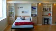 Wall bed and storage by California Closets