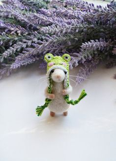 Needle felted mouse in a crochet frog hat The hat can be taken off. The mouse is approx. 6 cm tall (without the hat). Made from wool on wire