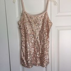 Nude sequin front cami Sequin front cami from Aeropostale. Good condition missing very few sequins. Only tag with washing instructions. Fits like a large Aeropostale Tops Camisoles