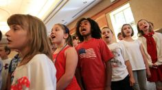 Students from Big Creek elementary school performs for the audience at the City of Middleburg Heights Memorial Day ceremony Friday, May 23, 2014. This city does Memorial Day on Friday to ensure the full participation of local school kids, who get to hear first hand from veterans. (Joshua Gunter/ The Plain Dealer)