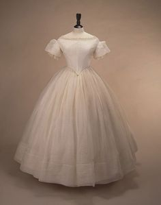 Bridesmaid's dress of fine white muslin, 1850's.