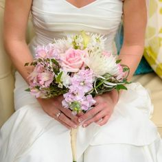 Heather's bouquet was full of roses, lilies, chrysanthemums, and anemones. The light pink flowers compliment her theme perfectly. Image credit: Andi Diamond Photography