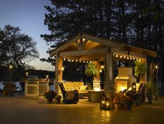 Love this, this is what we're going for in the back yard, but instead of string lights, we're going to use 3 different lanterns coming down from the center for lighting.  It's going to be super romantic and cozy =D
