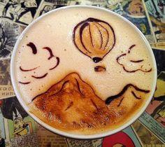 Coffee Art. Balloon over mountains.