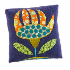 Make a folk art pillow using felted wool, cotton, ribbon and other embellishments.