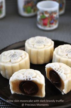 Snow skin chocolate Mooncake with dark brandy chocolate Truffle as the moon