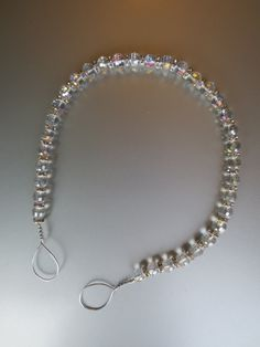 Beaded drapery tie-back with clear