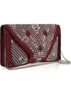 Isabel Marant Malou embellished suede clutch. Isabel Marant's Left Bank-cool accessories have fashionistas in a frenzy, and her bead-embellished and embroidered garnet suede clutch bag has gone straight to the top of our wish list. Work an on-trend Navajo-inspired look with jewel-hued leather layers and tasseled boots, amping up the adornment with feather necklaces and stacked bracelets. Isabel Marant Malou clutch: garnet suede, embroidery and silver bead embellishment, optional chain strap…