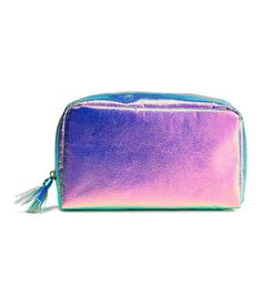 Metallic. Makeup bag in imitation leather with zip at top with tassel. Lined…