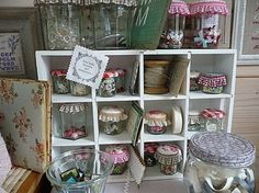 I love how these jars are displayed with ruffles and stitching.  So much prettier than just a jar...