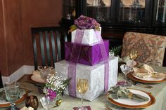 Great gift box centerpiece.  Easy, inexpensive, and can by customized to match the theme of any party!