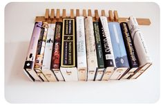 custom made wooden book rack bookshelf in oak the pins are also bookmarks. Black Bedroom Furniture Sets. Home Design Ideas