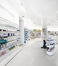 Lordelo Pharmacy by Jose Carlos Cruz Arquitecto.  #White space with a reflective ceiling. #Retail