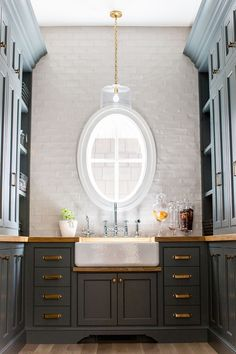 Butler's Pantry : Dark Cabinets : Wood Counter : Farmhouse Sink : Oval Window : Tile Bar White Glossy Subway Tile : New and Improved Kitchen Design Ideas