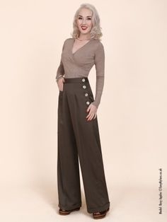 High waisted brown trousers with prominent buttons, less cleavagey blouse, brown/tan