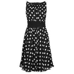 Festliches schwarzes Kleid von SWING. Modisches Kleid im 60er Jahre Stil mit allover Polka dots, Taillenband zum Schnüren und fließendem Stoff. Ein tolles Kleid, das in keinem Kleiderschrank fehlen sollte.