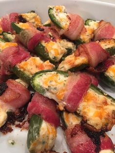 Cheddar, chive and honey filled jalapeño poppers, wrapped in bacon