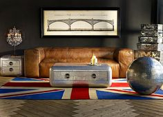 Industrial chic for the modern day urbanite. The Scruffy sofa's clean lines and simplicity of style exude a timeless elegance while the military-inspired Blackhawk coffee and side table inject a daring and rugged presence accessorised by the playful Spitfire Ball and stacked Raleigh Spitfire cases. #home #interiordesign #interiors #homedecor #styling #homestyle #livingroom #living #sofa #timothyoulton by timothyoulton