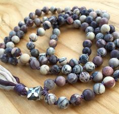 8mm Matte Porcelain Jasper Mala Beads, 108 Prayer Beads, Meditation, boho, yoga mala necklace, Silk and Linen Tassel. All natural Stone, Unisex Beads. Porcelain Jasper is a all natural stone with hues of eggplant, purple, cream peach and pink. Hand knotted for strength and