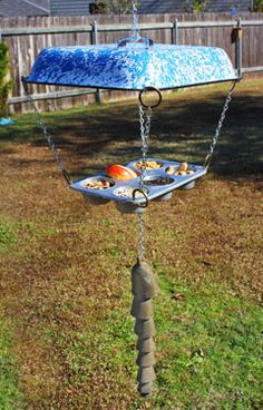 Old kitchenware becomes a cool birdfeeder! Learn more from Birds & Blooms.