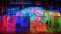rainbow-hued light labyrinth by brut deluxe forms an immersive infinity room in china
