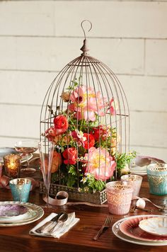 A birdcage wedding reception centerpiece from BHLDN