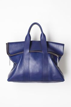 desperately looking for THE blue bag, this one comes close.. (3.1 Phillip Lim Spring 2012 )