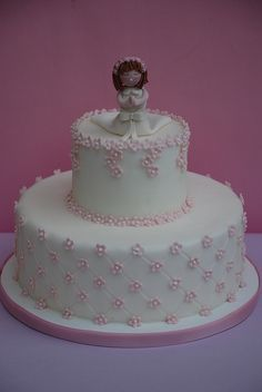 Torta de primera comunión para niñas.