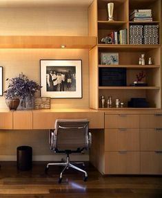 Here's a creative solution for city dwellers looking to maximize space: Brooklyn-based architect Peter Pawlak integrated a pair of built-in desks right into a couple's bedroom, creating a home office that can be hidden away when not in use.