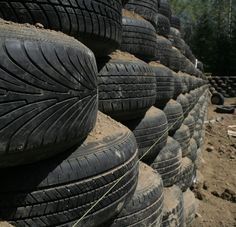 using tires for retaining wall - Look at how they use the string to maintaing a straight line.  Maybe I want to create more of a curve.