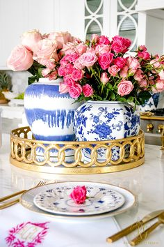 Pink roses on blue and white plates with gold flatware creates an adorable place setting. Top it off with pink roses in blue ginger jars--happiness! - Trend Alert Pink and Blue - Randi Garrett Design