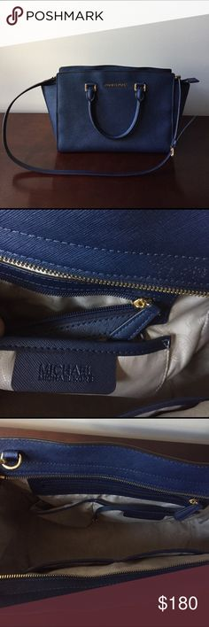 🎉price cut 🎉Michael Kors Navy Selma Satchel Made with Saffiano leather.  Beautiful navy color. 13x6x10. Great Condition. Comes with dust bag. One small white mark as shown in picture. No trades. MICHAEL Michael Kors Bags