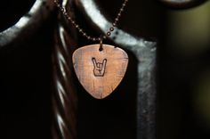 Guitar pick necklace by OutRayJessMetal on Etsy, $9.00