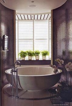 Dramatic bathroom with round tub